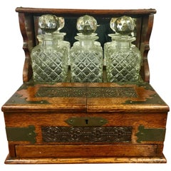19th Century English Oak and Crystal Tantalus Decanter Set