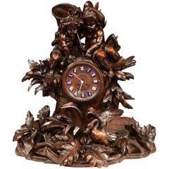 19th Century Swiss Black Forest Carved Walnut Mantel Clock with Cherubs and Bird