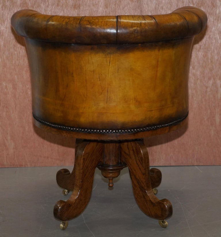 Important Antique Chesterfield circa 1860 Restored Brown Leather Captains Chair For Sale 8