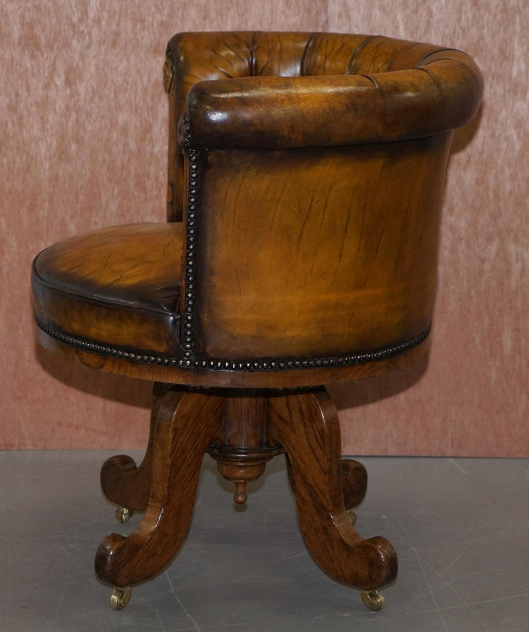 Important Antique Chesterfield circa 1860 Restored Brown Leather Captains Chair For Sale 9