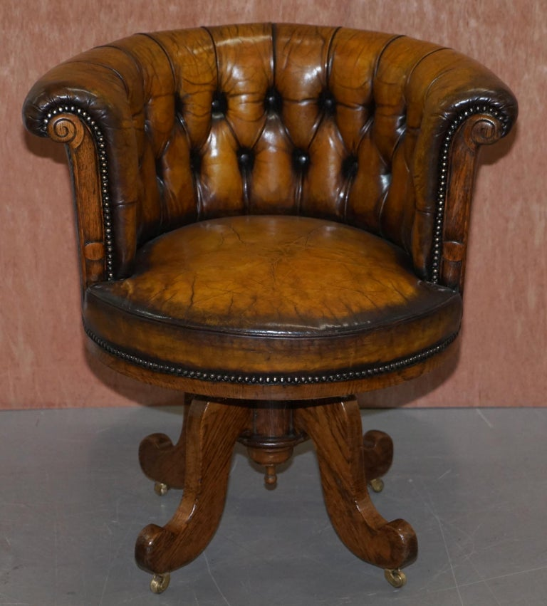 We are delighted to offer for sale this very rare and important fully restored circa 1860 barrel back Chesterfield hand dyed brown leather office chair  This chair is really quite exquisite, its one of the earliest types of swivel chairs I have