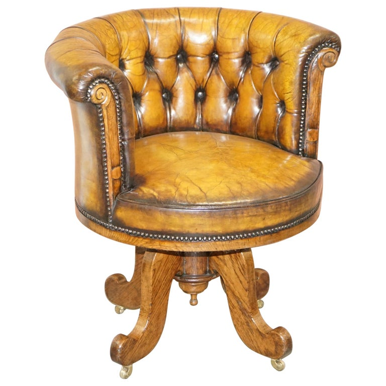 Important Antique Chesterfield circa 1860 Restored Brown Leather Captains Chair For Sale