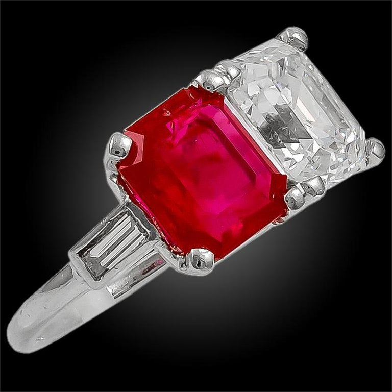 Rare Cartier ring comprising an emerald-cut diamond and an emerald cut Burma no-heat ruby weighing approximately 3.07 carats, aligned side by side. Signed Cartier. Burma ruby weighing approx. 3.07 cts. with AGL cert. Ring size 5 3/4