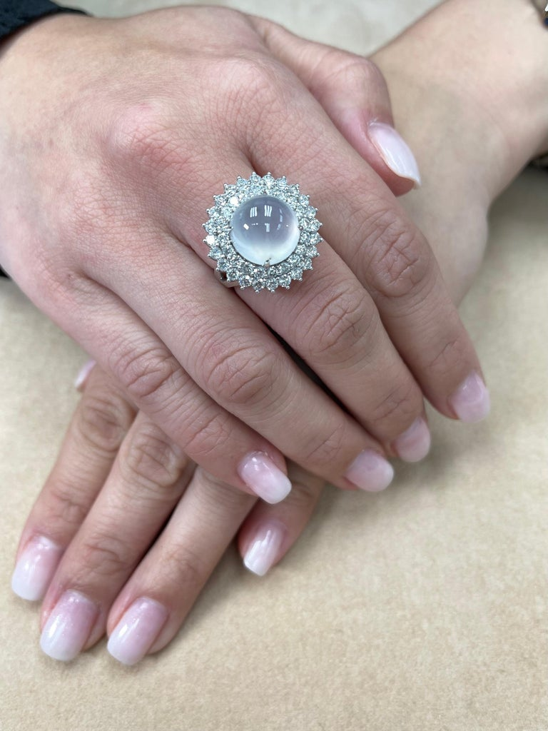 THIS JADE GLOWS! Here is a super rare ICY Jade and diamond ring. Oversize icy jade of this quality is extremely rare. It is certified natural jadeite jade with no treatment or enhancement. Under very strong lighting of the light box, you can see