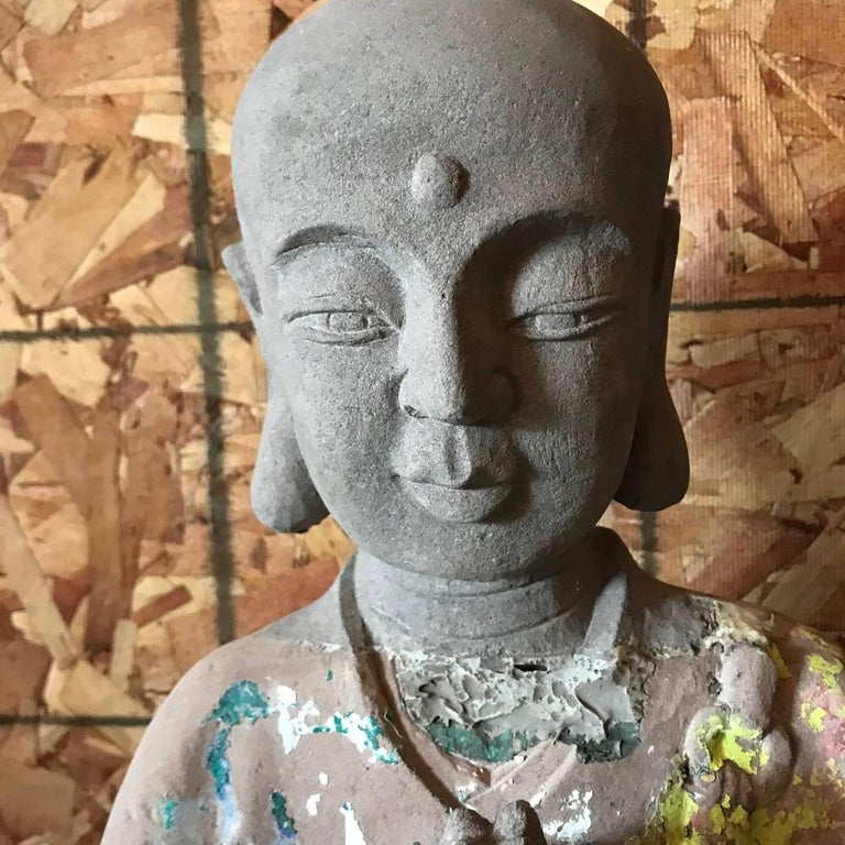 China, an authentic antique hand-carved and hand-painted limestone temple figure of the venerable lohan, Kasyapa.  This beautiful Buddhist sculpture will bring serenity and timeless style to your home, office, sacred space, or garden  Substantial