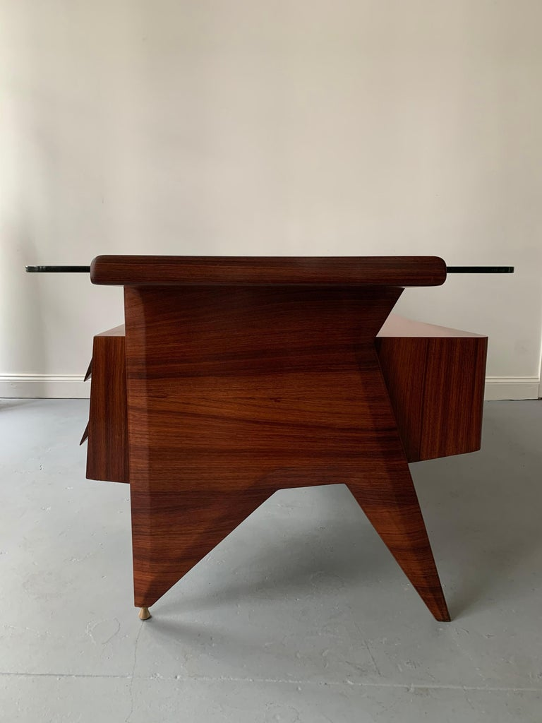 """Important desk designed by Gio Ponti. Produced by Dassi. Measures: L 79"""" x W 34.5""""x H 30.5"""" Mahogany, glass and brass (brass sabots are adjustable) 1949, Italy  Letters of authenticity 1. Laura Falconi (expert of Gio Ponti) wrote 26 page"""