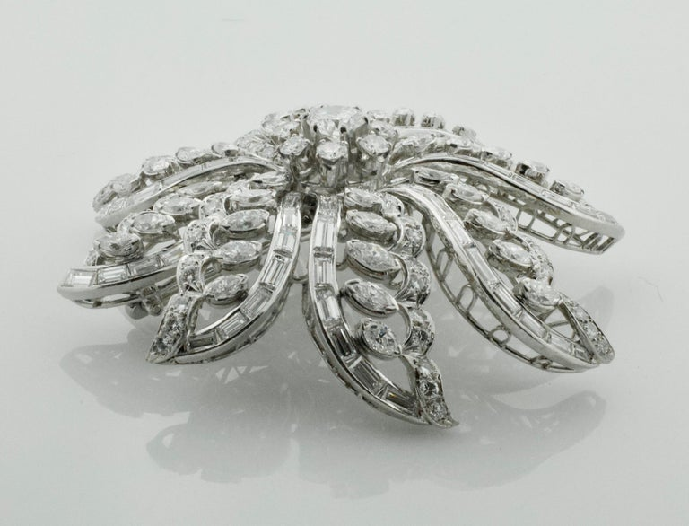 Important Diamond Flower Brooch in Platinum circa 1940's 15.65 carats  One Round Brilliant Cut Diamond weighing .85 approximately [GH-VS1] approximately Thirty Seven Marquise Cut Diamonds weighing 6.75 approximately Seven Round Brilliant Cut