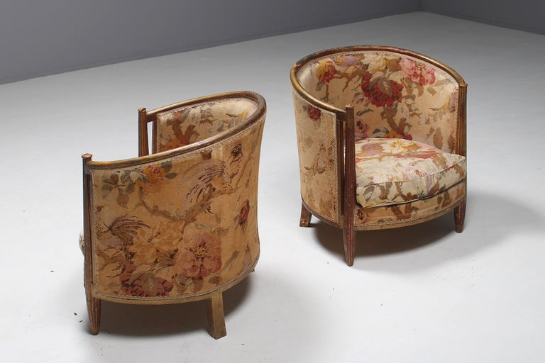 This pair of club chairs is designed by the well-known French Art Deco designer Paul Follot. Follot was not just a designer but a real artist and trained as sculptor. From 1904 Follot headed his own decorating company, catering to a wealthy