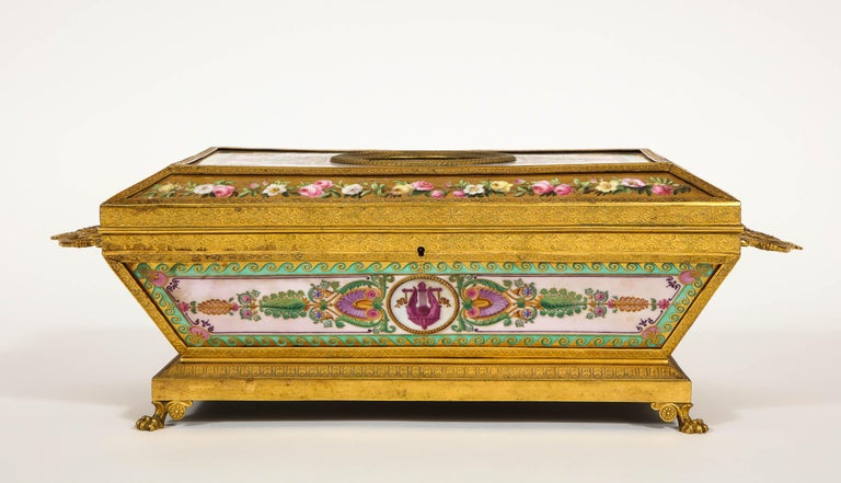 An Important and very rare Empire period Paris porcelain ormolu-mounted Empire rectangular shaped two-handled casket decorated and assembled by Feuillet or Sèvres Porcelain manufactures. The cover inset with a simulated hard stone cameo of Ceres in