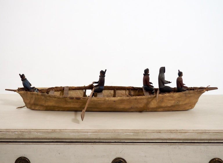 Important Eskimo miniature boat, with carved and original painted wood figures, 19th century.