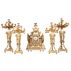 Important Five Pieces Marble and Gilded Bronze Clock Set