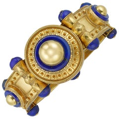 Important Gold and Lapis Bangle by Cartier