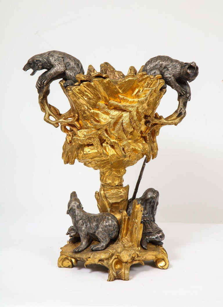 Important ormolu and silvered bronze figural wine cooler, possibly Russian, 1860  Gilt and silvered bronze wine cooler. Modeled with two Russian polar bears at the handles and with a young gunmen holding a rifle seated with a sea otter.  Very