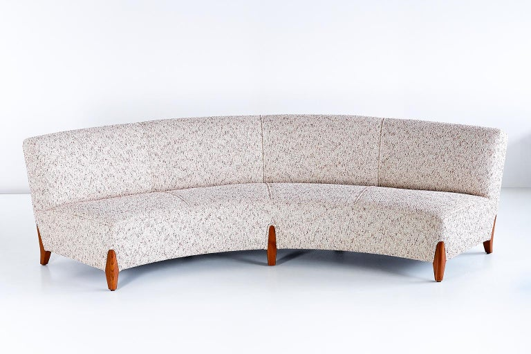 This important curved sofa was designed by Otto Schulz and produced by his company Boet in Gothenburg. The generously sized sofa can comfortably sit four people. The sofa has been newly upholstered following the measurements and details of the