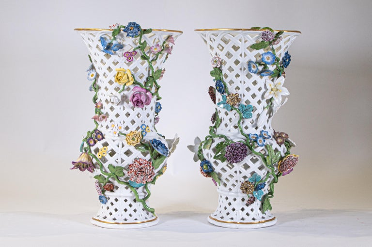 A Highly Important pair of Museum Quality Louis XV Period 18th century Meissen Porcelain filigree openwork vases with a medially of flowers and vined leaves. This is truly an exceptional pair of Meissen Porcelain vases with a truly gorgeous design