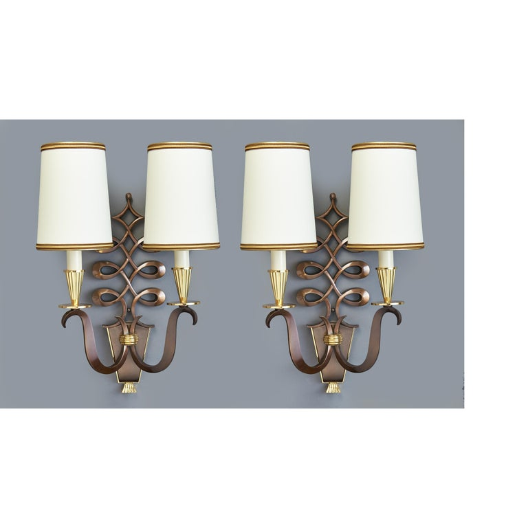 Genet et Michon Philippe Genet ( b.1882 ) et Lucien Michon, ( 1887-1963 ) Beautifully cast pair of sconces with elaborate scroll motif and elegantly turned arms in oxidized sculptural bronze with polished bronze highlights. France, circa