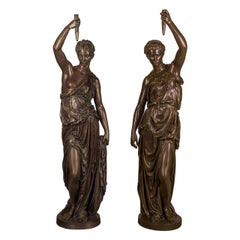 Important Pair of Monumental Parcel-Gilt and Patinated Bronze Figural Torchèr