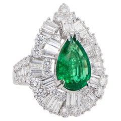 Important Pear Shaped Emerald Ring 2.25 Carat Set in Diamond Setting 3.45 Carats