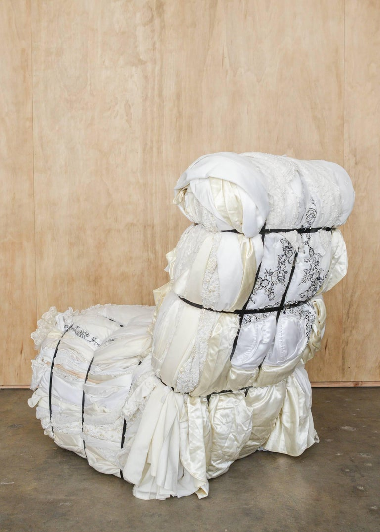 An important custom ordered Tejo Remy (Dutch b. 1960) rag chair for Droog design. One of a kind and Individually hand crafted from 100+ pounds of customer supplied wedding dresses bound with steel straps.