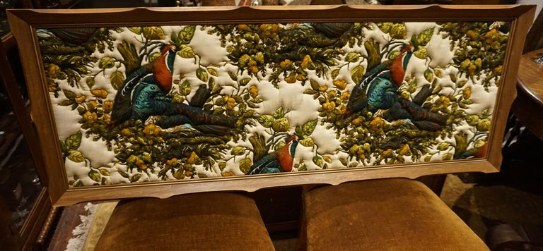 Unique and large frame hand quilted pheasants that stand out in vivid hues. Imported artwork and sold by the heritage Woodwards Store in Canada. Excellent for use in study or bedroom,  circa 1935-1945.