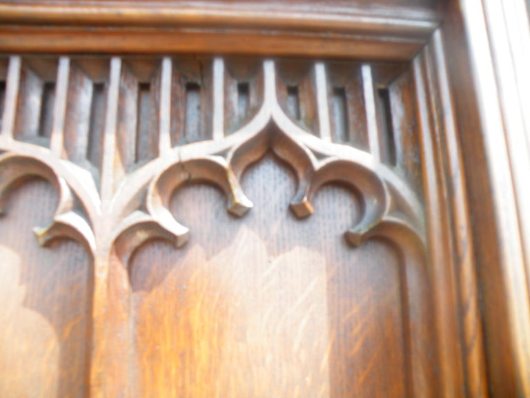 Imposing Reformed Gothic Oak Fireplace Mantel Surround 1870s with Mirror In Excellent Condition For Sale In Hudson, NY
