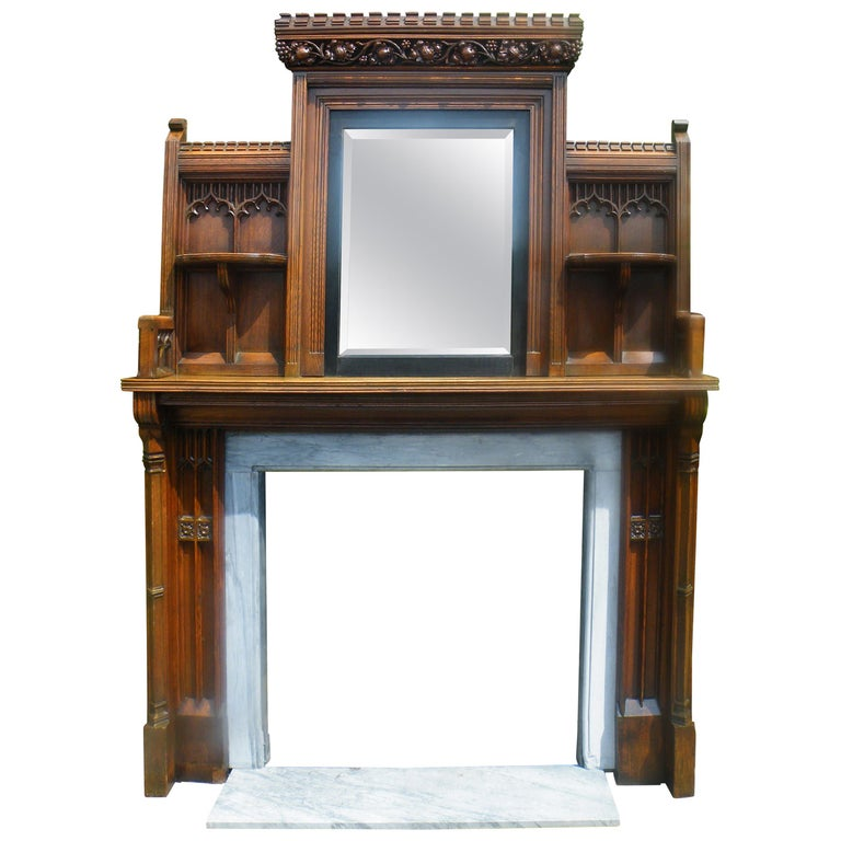 Imposing Reformed Gothic Oak Fireplace Mantel Surround 1870s with Mirror For Sale