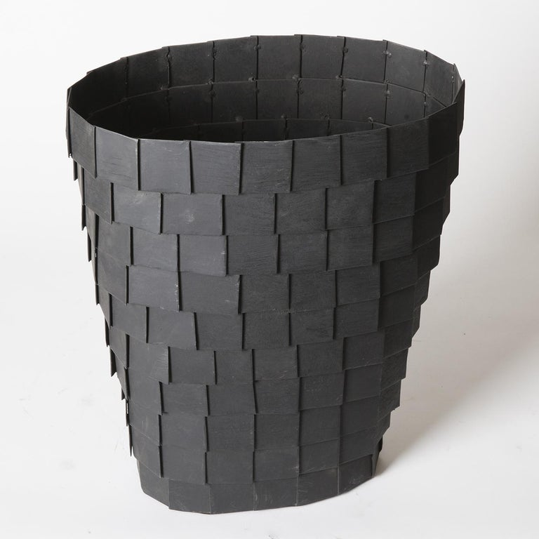 This dramatic piece by Sciortino is a truncated cone vase sculpture in panels of sheet iron, painted matte black to retain the impression of rough metal.