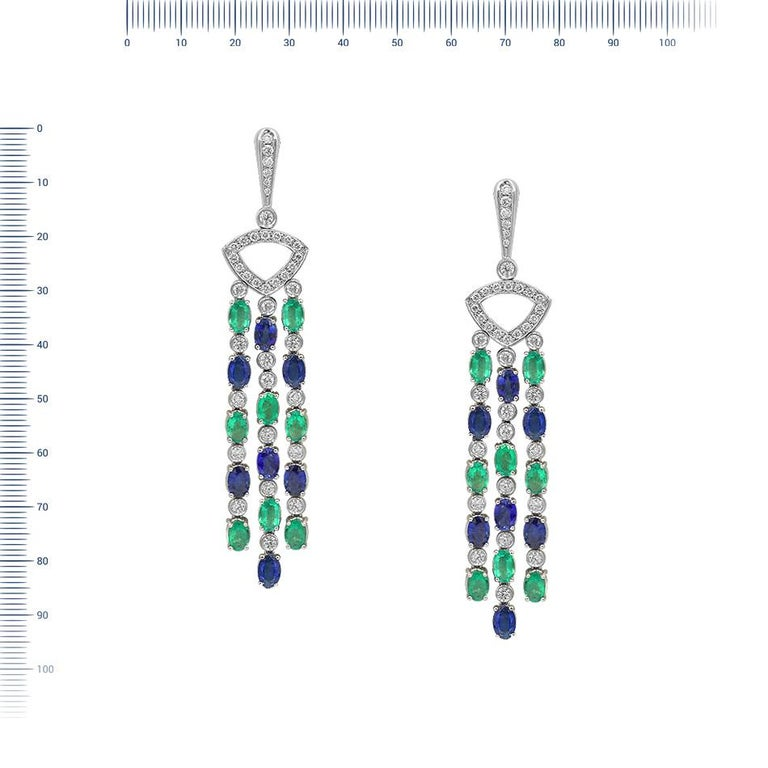 Earrings  Gold 18 K Diamond 34-Round 57-1,73-4/6A  Diamond 42-Round 57-0,8-4/5A  Diamond 2-Round 57-0,01-4/5A  Blue sapphire 14-Oval-8,4 Т(4)/3A  Emerald 16 Weight 29,67  With a heritage of ancient fine Swiss jewelry traditions, NATKINA is a Geneva