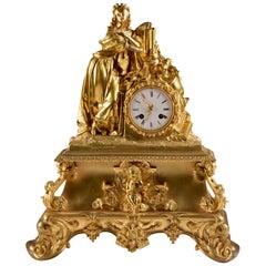 Impressive bronze fire-gilt pendulum clock, with a beautiful woman, 1820