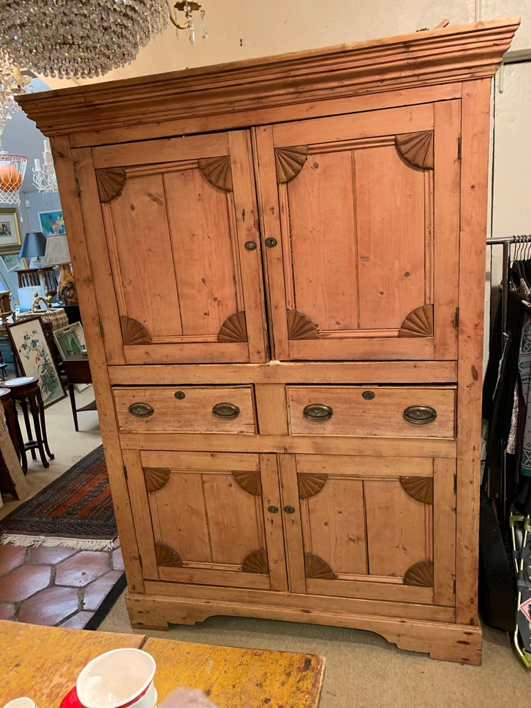 A very large natural rustic Irish pine cabinet hutch with paneled doors top and bottom separated by two drawers. Tons of storage and Americana charm. Measures: Body is 51 W, 24 D Shelf in top is 17