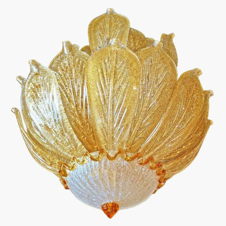 Impressive stunning and rare 26 gold leaf Venetian Murano chandelier by Barovier & Toso. Handblown textured crystal sparkling glass with gold inclusion. This gorgeous light fixture is suspended by a High Quality 24-karat gold-plated brass