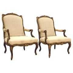 Impressive Pair of French Mid 18th Century Black and Gilt Rococo Armchairs