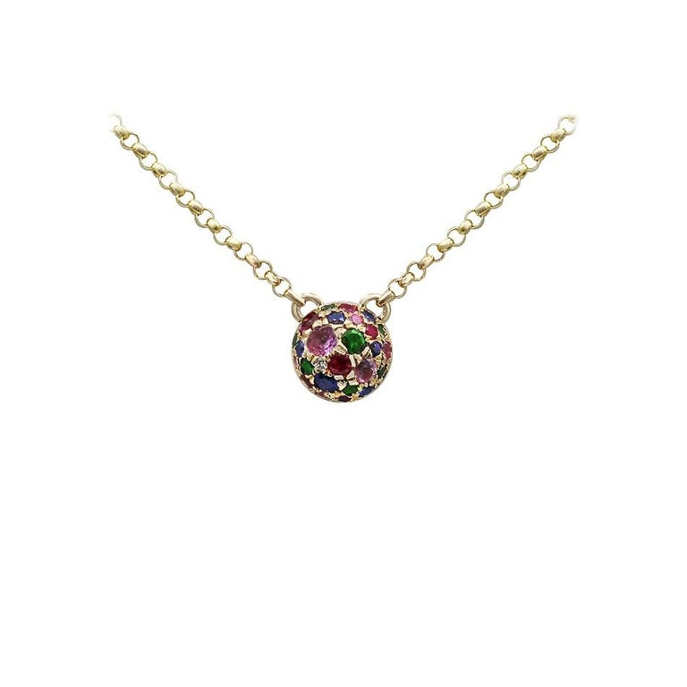 Necklace Yellow Gold 14 K   Diamond 1-RND-0,01-G/VS2A  Pink Sapphire 6-0,09ct Sapphire 6-0,06ct Ruby 6-0,07ct Tsavorite 7-0,06ct  Weight 2.29 grams Length 45 cm  With a heritage of ancient fine Swiss jewelry traditions, NATKINA is a Geneva based