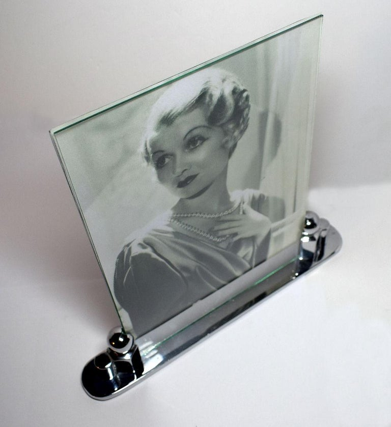 For your consideration is this very stylish and authentic Art Deco chrome picture frame which originates from France. The base of the frame is deceptively heavy and of great styling. Two pieces of glass hold the photograph in place, a picture can be