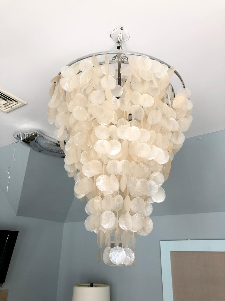 Iconic design of cascading layers of shell in a monumental size. Drop from ceiling to top of fixture is 17.5.