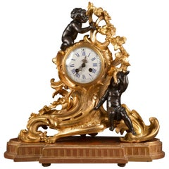 Rococo Style Bronze Gilded Pendule with Cherubs on Wooden Console, circa 1850