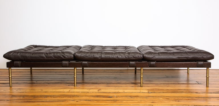 The Campanha collection displays DLV's take on classical Campaign furniture. Infused with a rugged-meets-refined aesthetic, the collection's tufted leather upholstery details are offset by careful and precise facets of gleaming turned brass and