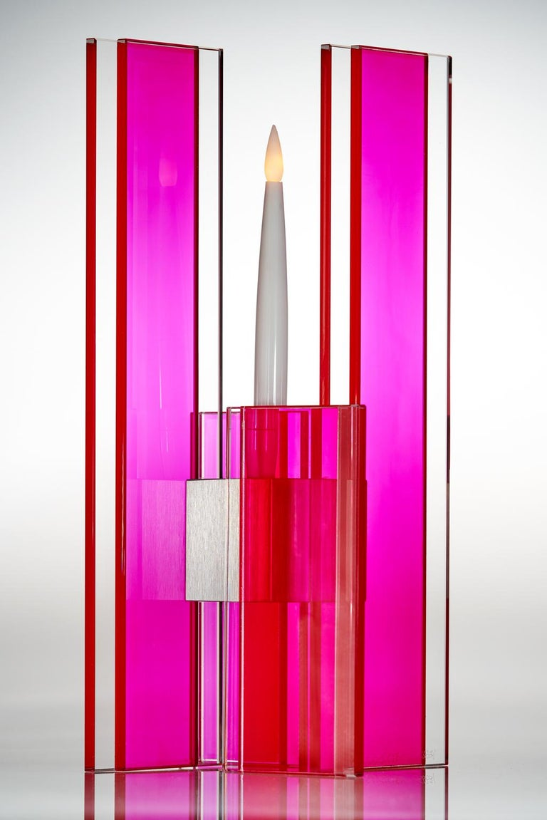 This polished glass candleholder is designed by world renowned glass artist, Sidney Hutter. With 40 years of experience in the contemporary glass and fine art world, Sidney now creates illuminated designs for the home. Create a centrepiece or add