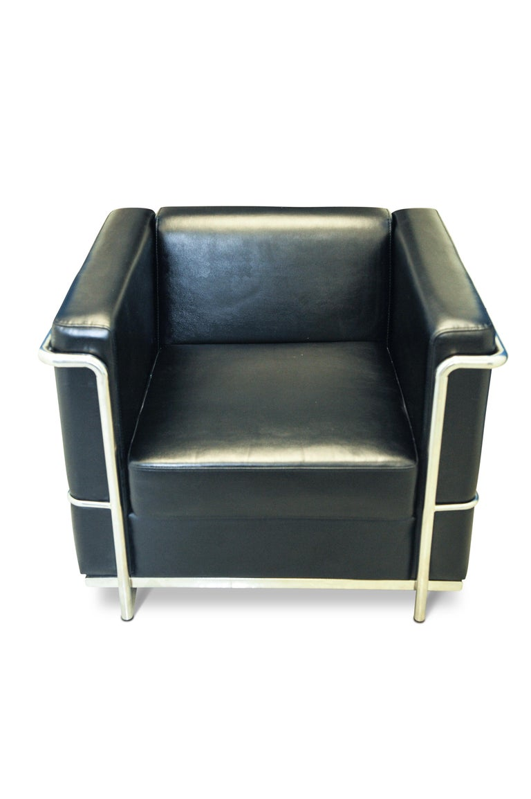 In the manner of Le Corbusier, A LC2 black leather armchair within a chrome frame.  This chair has most certainly been styled to represent the iconic Corbusier LC2 lounge chair of the 1920s. Designed by Charlotte Perriand and Pierre