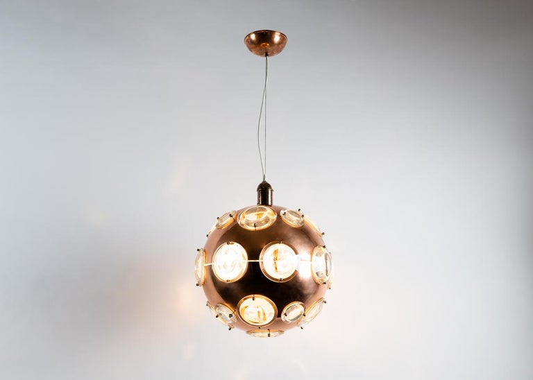 A playful, midcentury chandelier in copper, brass, and glass reminiscent of an early diver's helmet.
