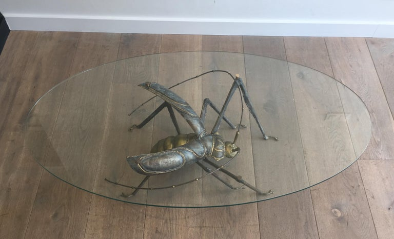 This rare coffee table is made of brass and wrought iron. This is a very interesting work showing a grasshopper. This table is in the style of famous French designer Jacques Duval Brasseurr, circa 1970.