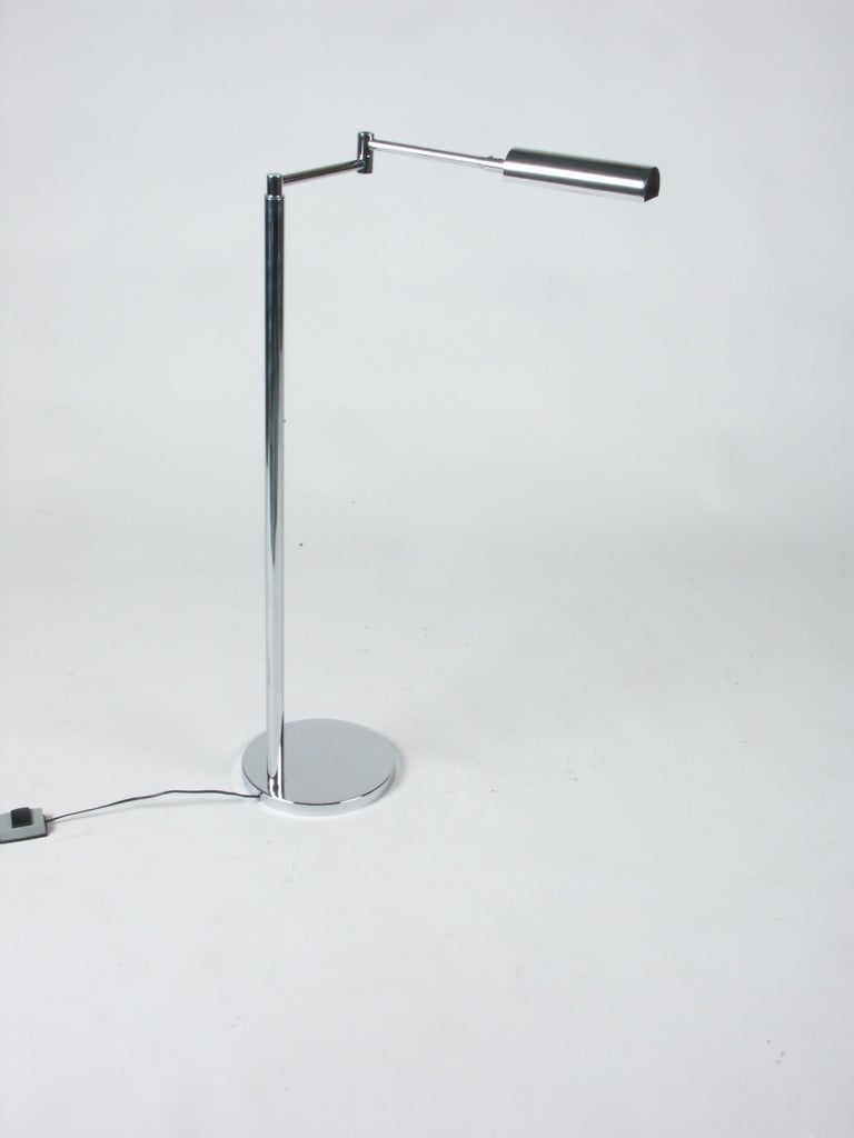 In the style of Cedric Hartman or Walter Von Nessen, this chrome Mid-Century Modern floor lamp is fully adjustable. Chrome is in nice bright condition, take elongated bulb.    Measurements: Height can be adjusted from 41.5