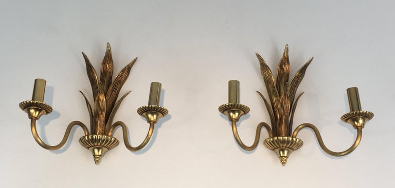 This pair of sconces is made of brass and bronze palm tree. These wall lights are very decorative and the quality is really good. This is a French work in the style of famous French designer Maison Charles, circa 1970.