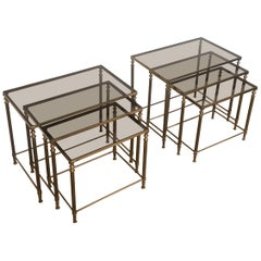 In the style of Maison Jansen. Pair of Neoclassical Nesting Tables Sets in Brass