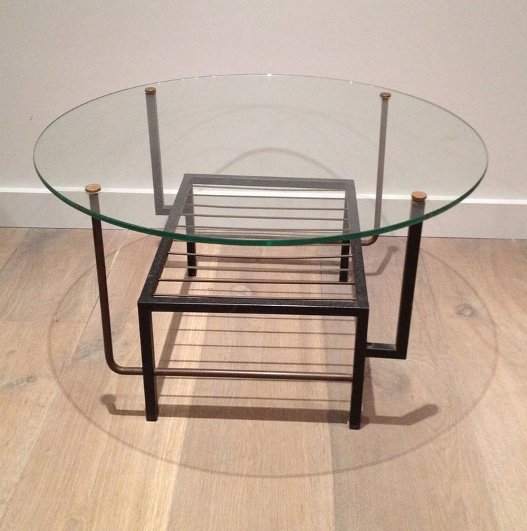 This very nice small round coffee table is made of black lacquered metal and brass with a round glass shelf. This a great design, in the style of famous French designer Mathieu Matégot, circa 1970.