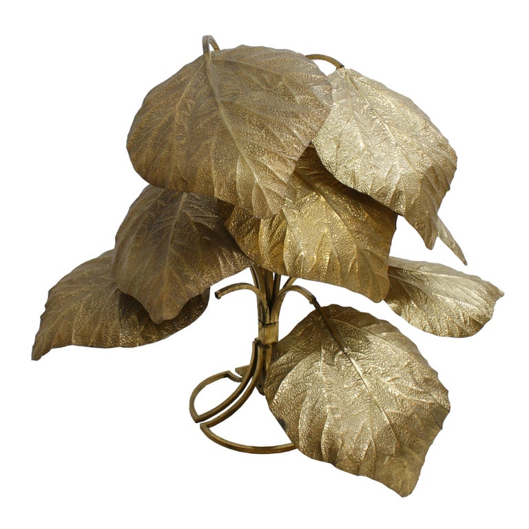 Tommaso Barbi floor lamp composed of eight leaves and structure made in brass, contains one point light for each leaf. Italy, 1970s.