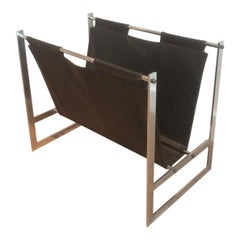 In the Style of Poul Kjaerholm, Brushed Steel and Black Leather Magazine Rack