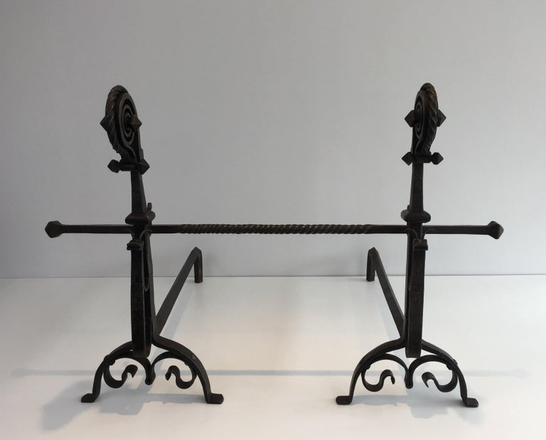 This exceptional pair of andirons is made of a hammered wrought iron. This beautiful work represents
