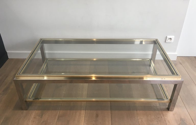 This very nice coffee table is made of chrome and brass. The quality of this cocktail table is very good. This is a French work, circa 1970.