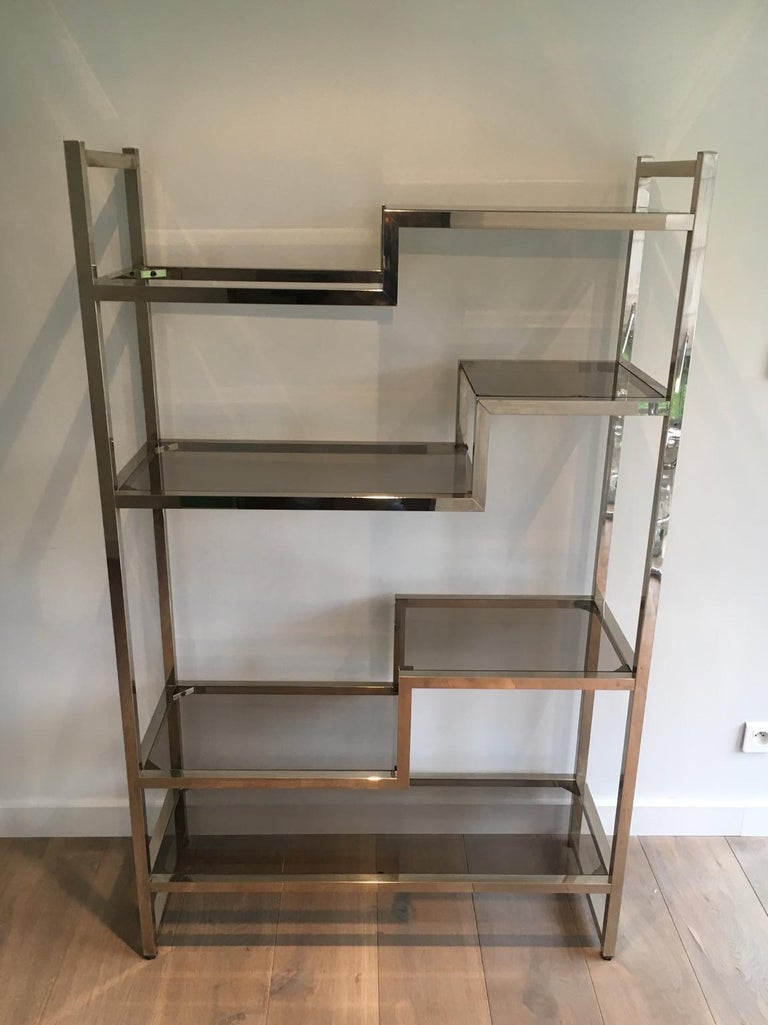 This design shelves unit is made of chrome and smoked glass tops. This is a French work in the style of famous designer Willy Rizzo, circa 1970.